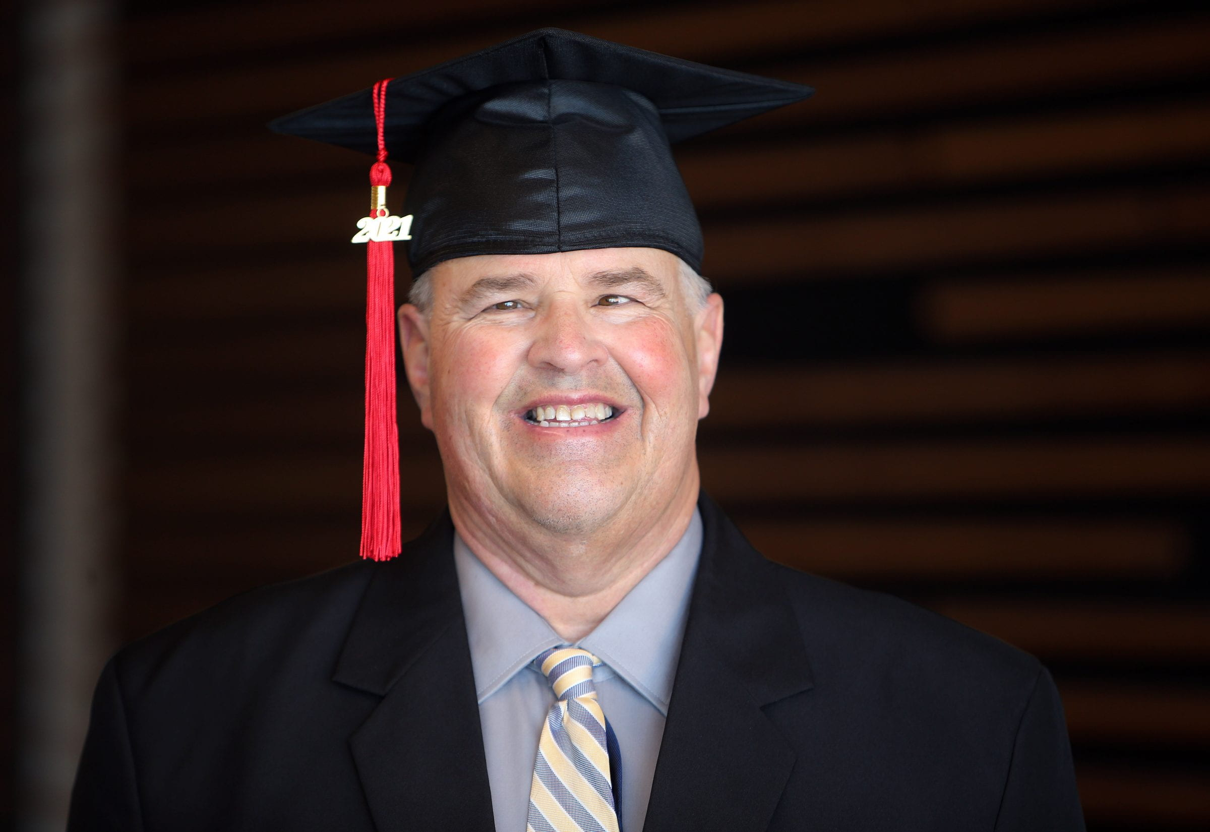 Red River College Polytechnic Honorary Diploma recipient Gabriel Langlois in graduation cap with tassel