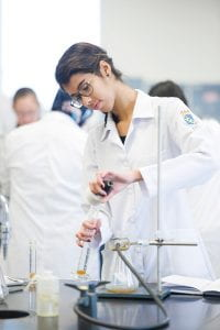 Woman mixing chemicals