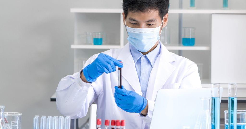 Lab worker examining blood sample