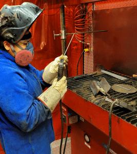 Monique Moneas with welding equipment