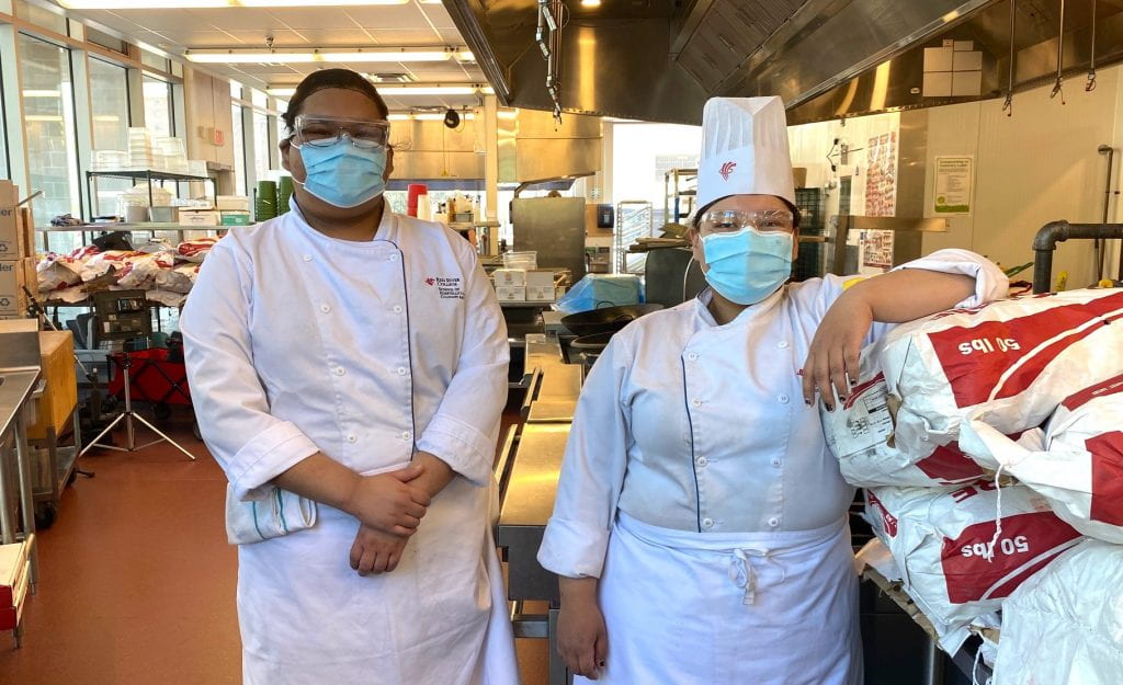 Culinary Skills studens Leona Monais and Sharnell McDougall in the culinary lab at Paterson GlobalFoods Institute