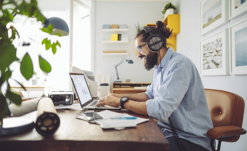 Man working at desk in home office