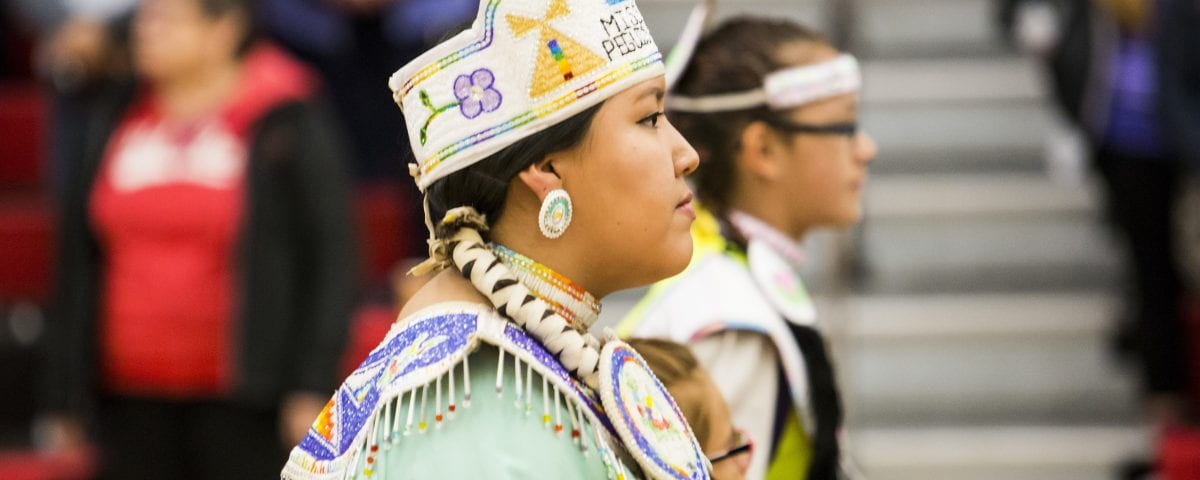 A woman is pictured at an Indigenous Pow Wow celebration