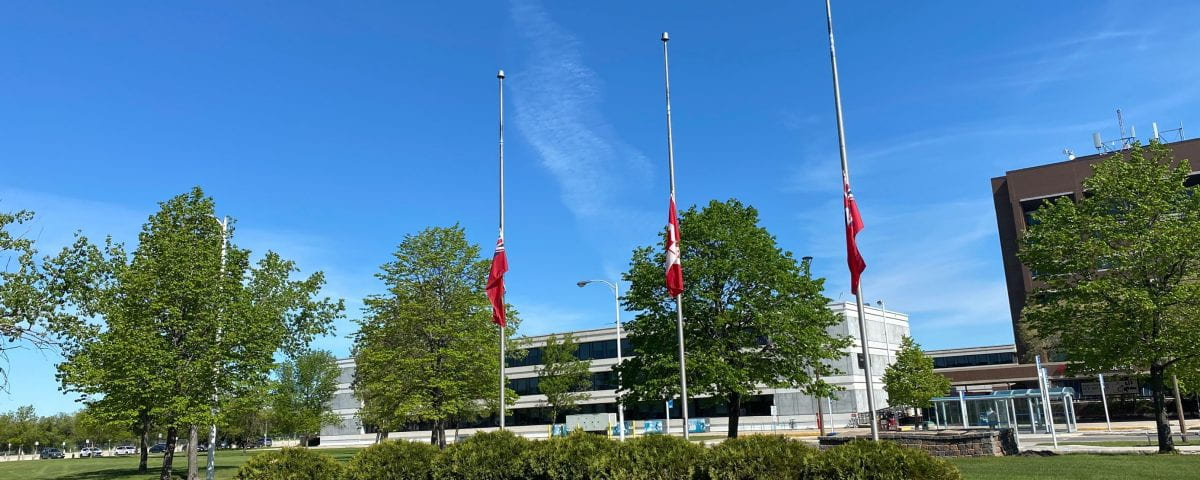 Campus flags are lowered at half mast outside campus