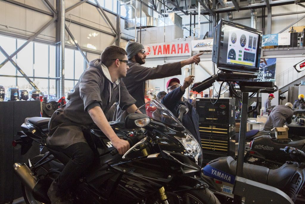 Marine and Powersports students working on a motorcycle