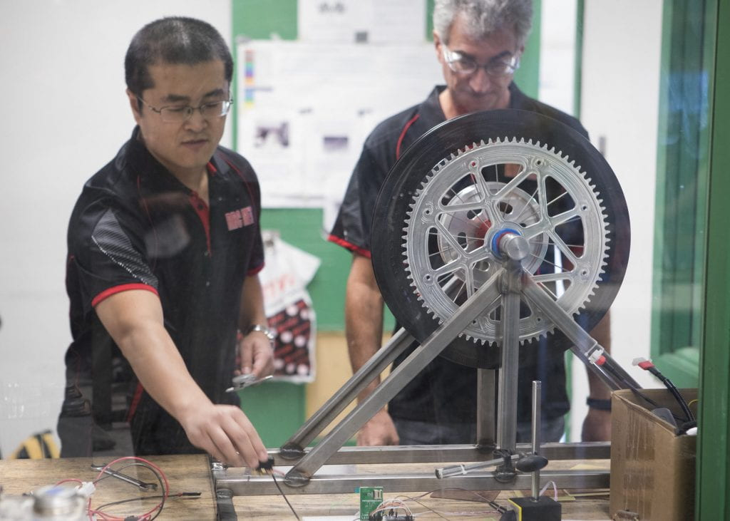 Student and instructor working on battery-electric vehicle