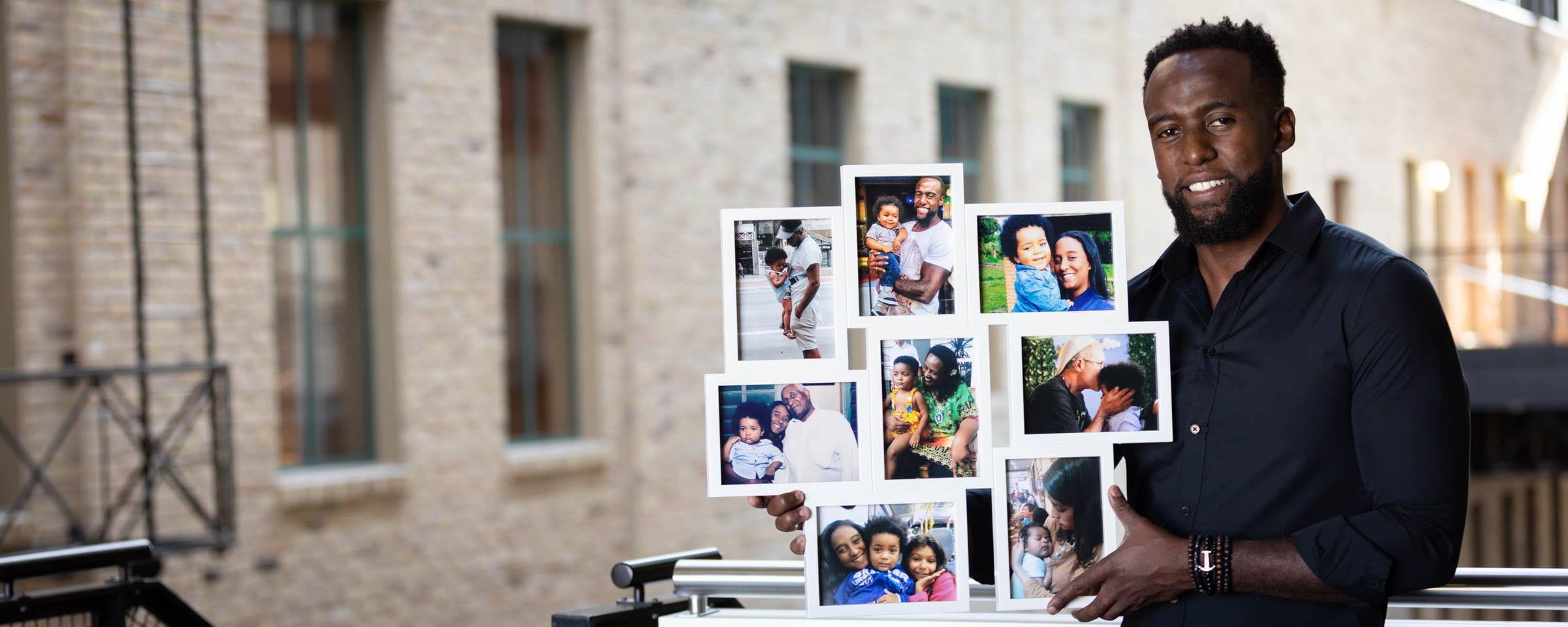 Flavio Raphael with photos of nephew Yuri César