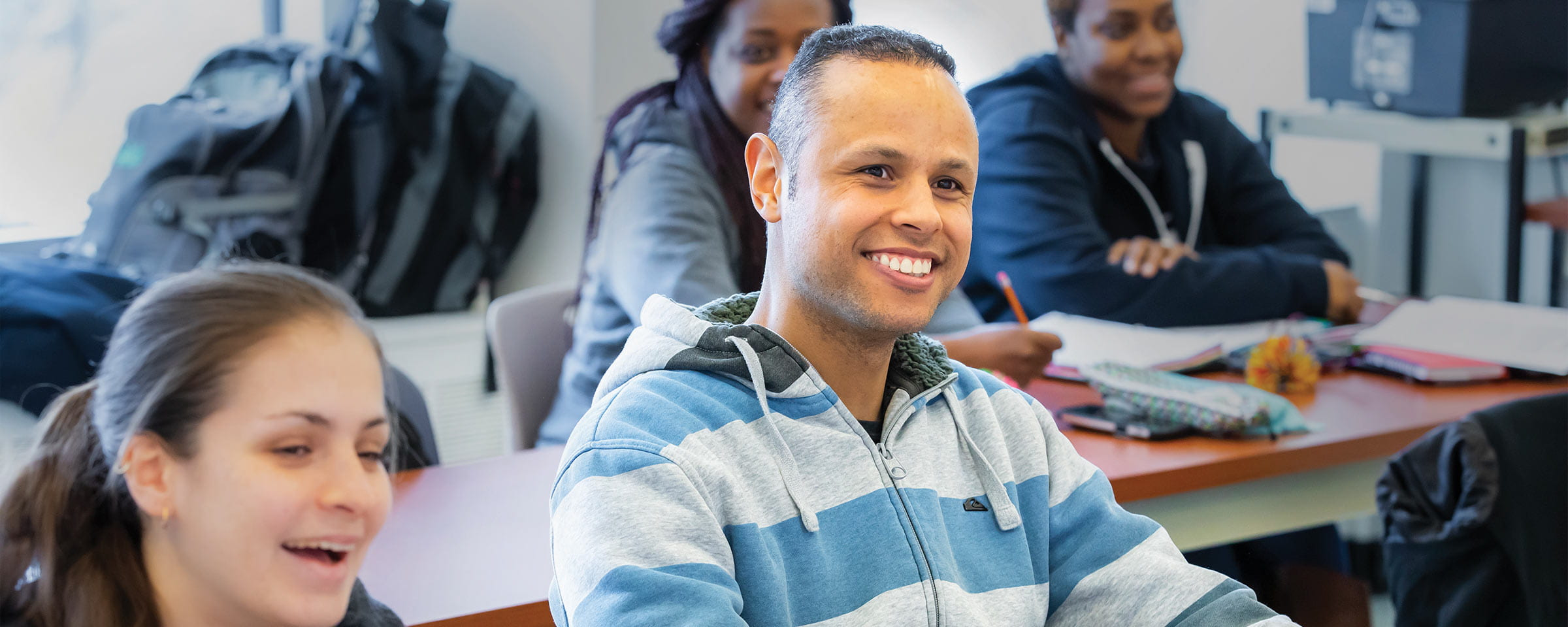 Smiling male student in classroom