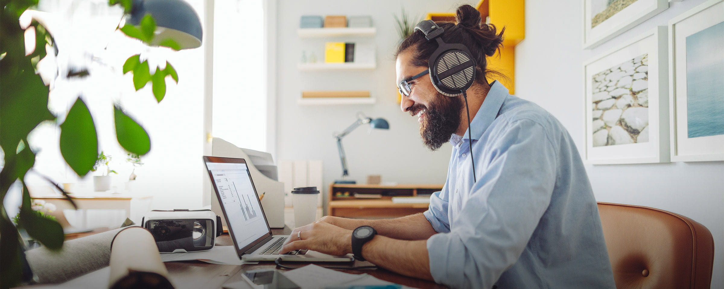 Man at laptop with headphones