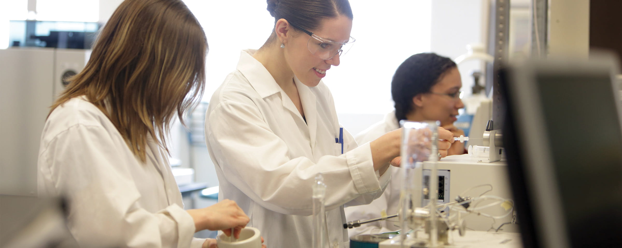 Three female students in health sciences lab