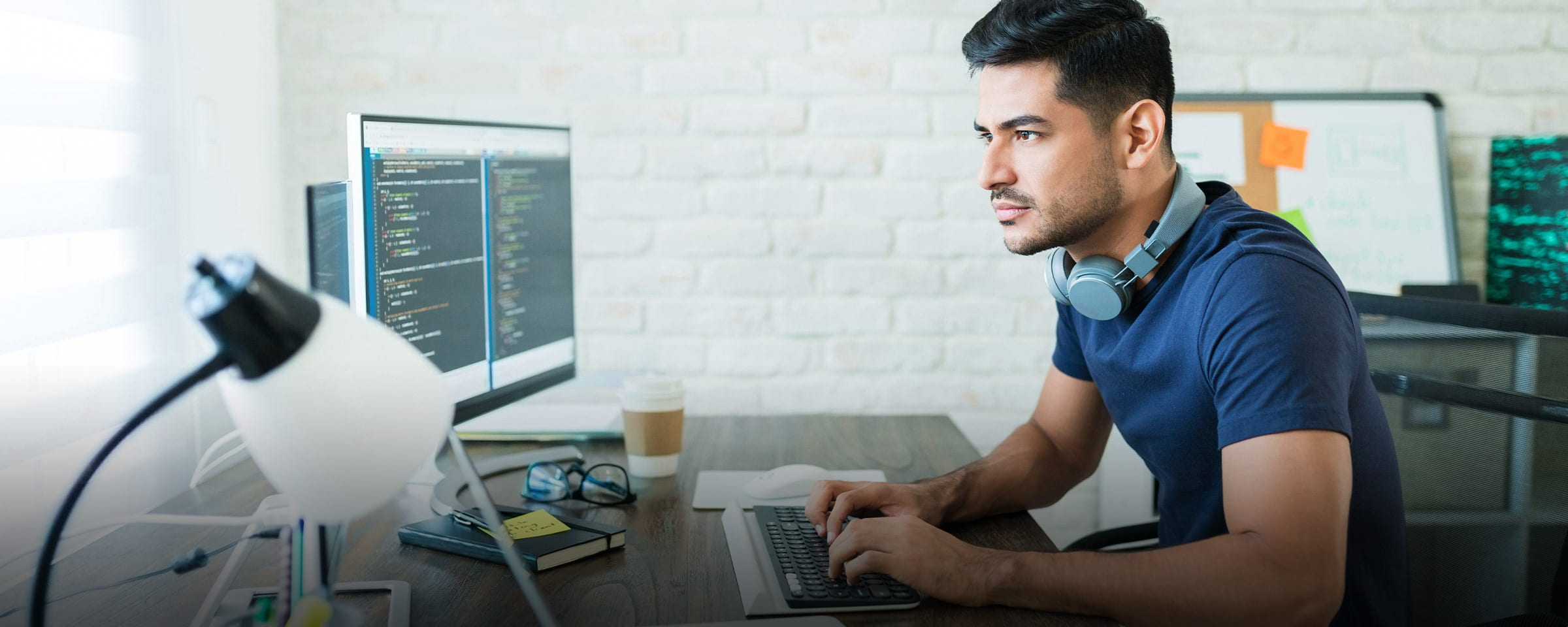 Man at desk working on computer