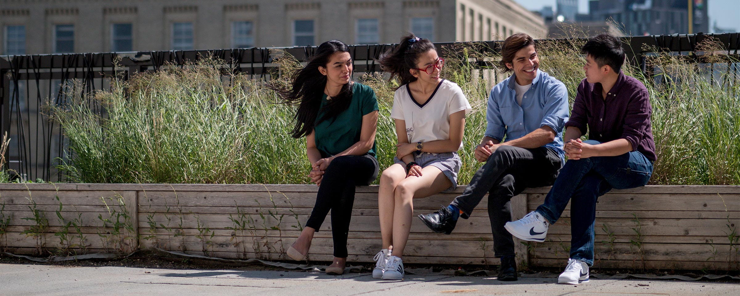 Four students conversing outside