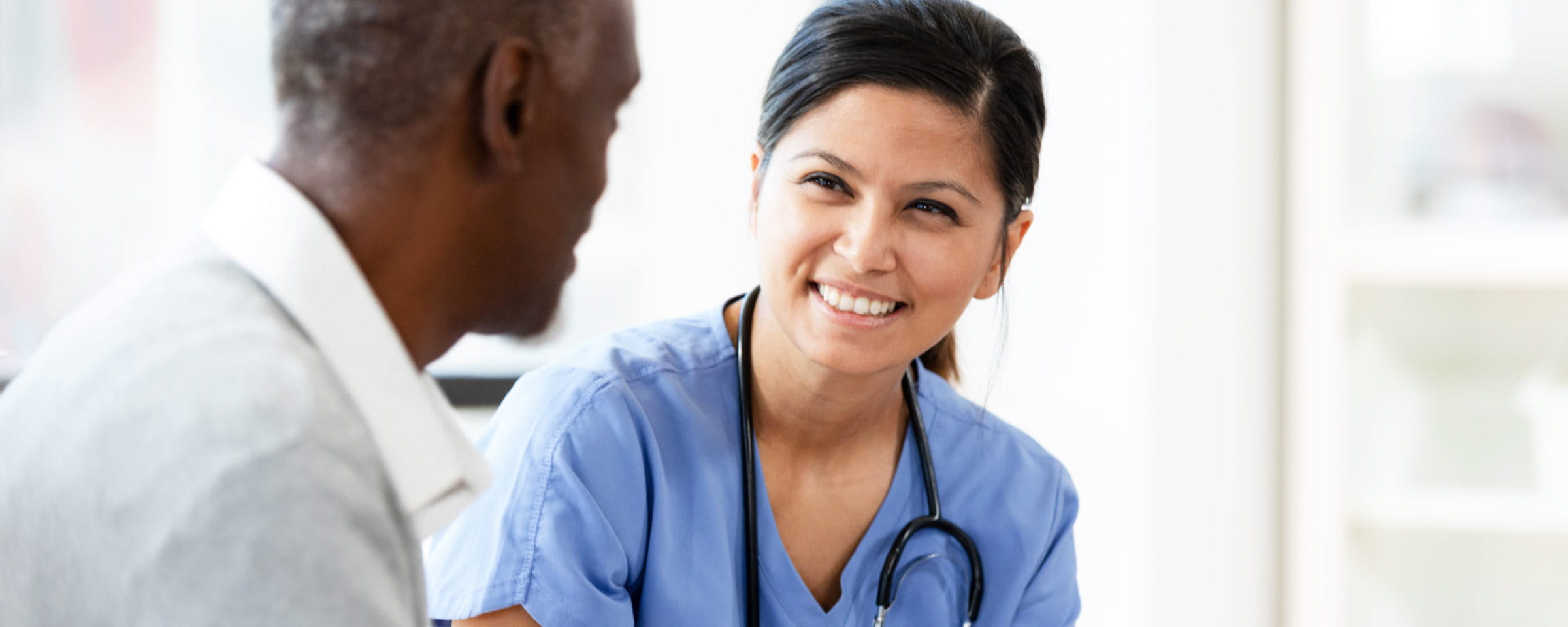 Female heath-care worker talking to male client.