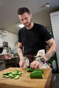 Adam Donnelly preparing food