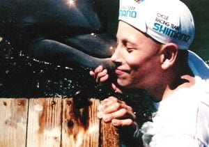 Kyle Romaniuk with dolphin