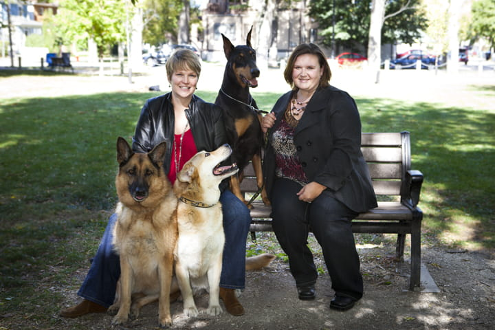 Tannis Rentz and Mary Robinson, with dogs