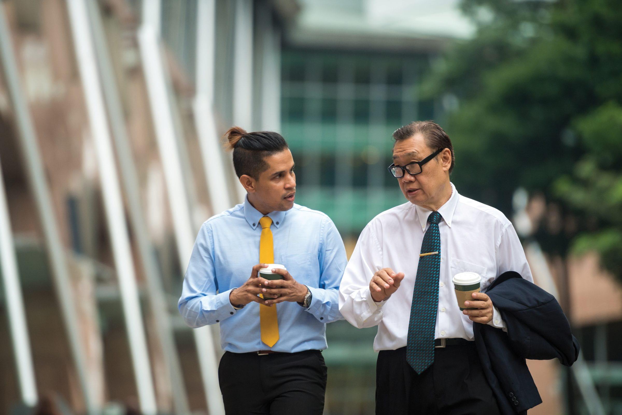 Senior alumni professional mentoring a millennial student