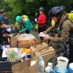 Cyclists enjoying free treats at the RRC Bike to Work Day Pit Stop