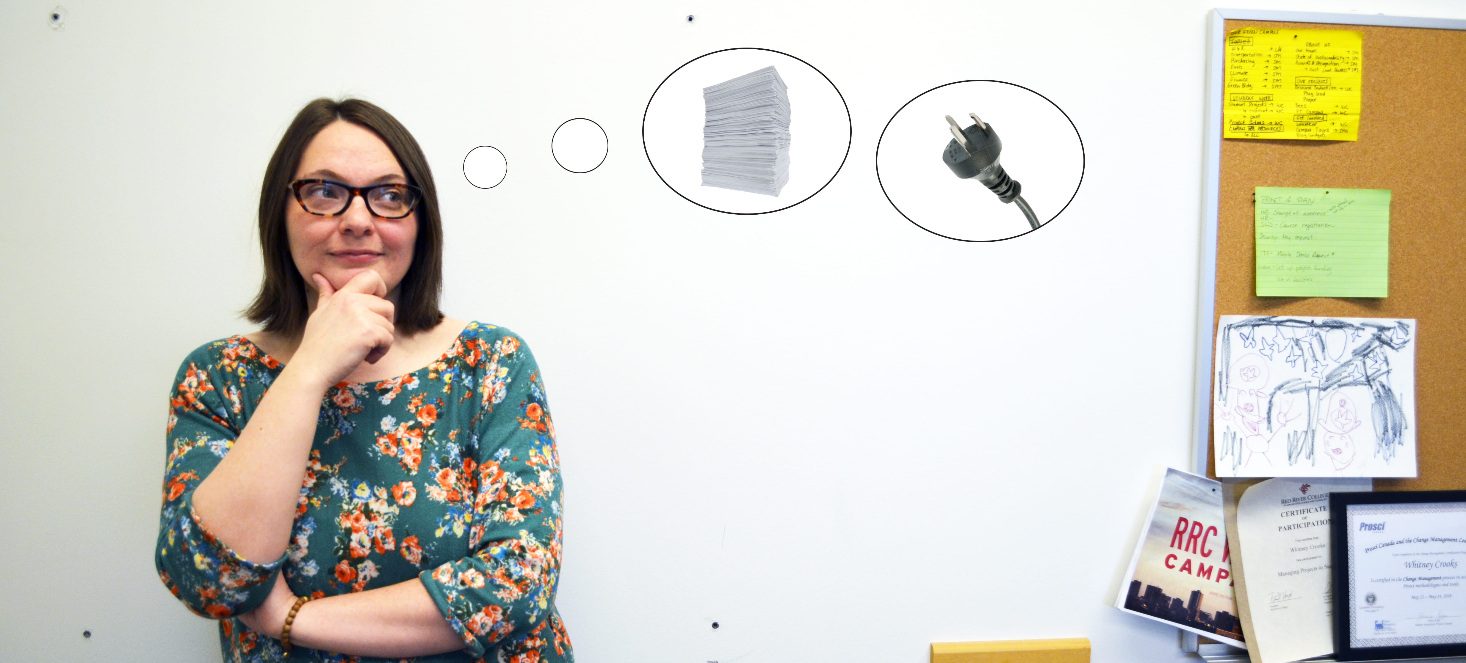Whitney Crooks, Resource Reduction Specialist, ponders the concepts of paper and plug load reduction through little thought bubbles in her office.