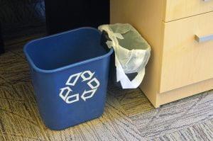 A small desk-side mini bin. It's a blue recycling bin with a smaller garbage bin attached.