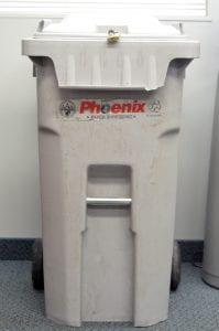 A light gray temporary shredding bin with two wheels.