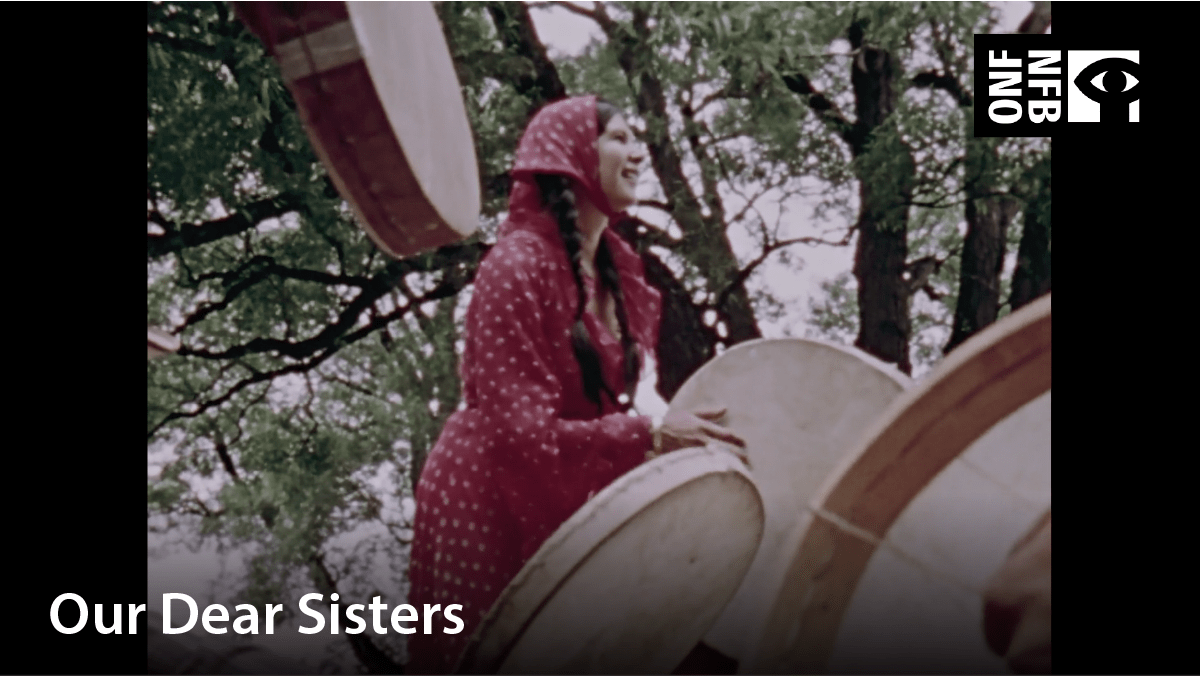 Young Indigenous girl participating in drumming group. Film title: Our dear sisters
