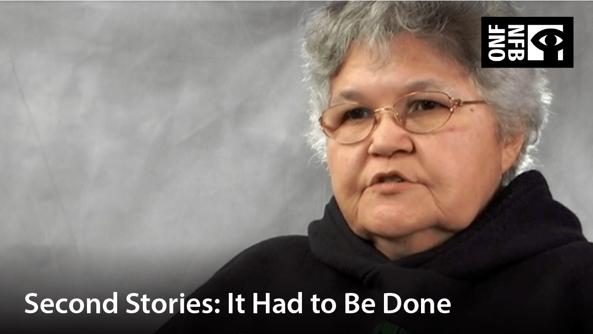 Indigenous woman with glasses, speaking. Film title: Second stories: it had to be done.