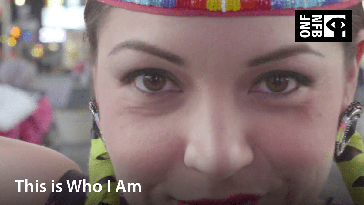 Indigenous girl dressed in dancing attire. Film title: This is who I am