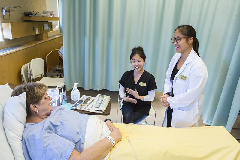 Health care professionals at patient bedside