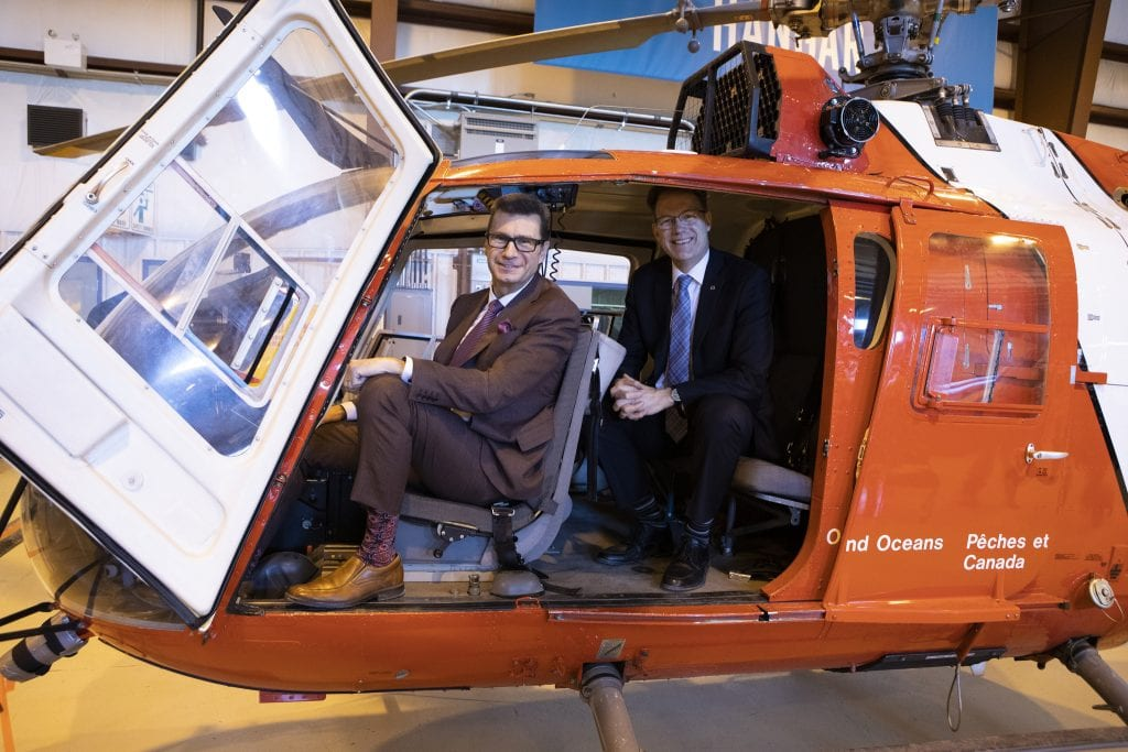 MP Doug Eyolfson and RRC President Paul Vogt, inside Coast guard helicopter