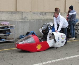 Students with battery-electric racer