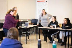 Students using American Sign Language