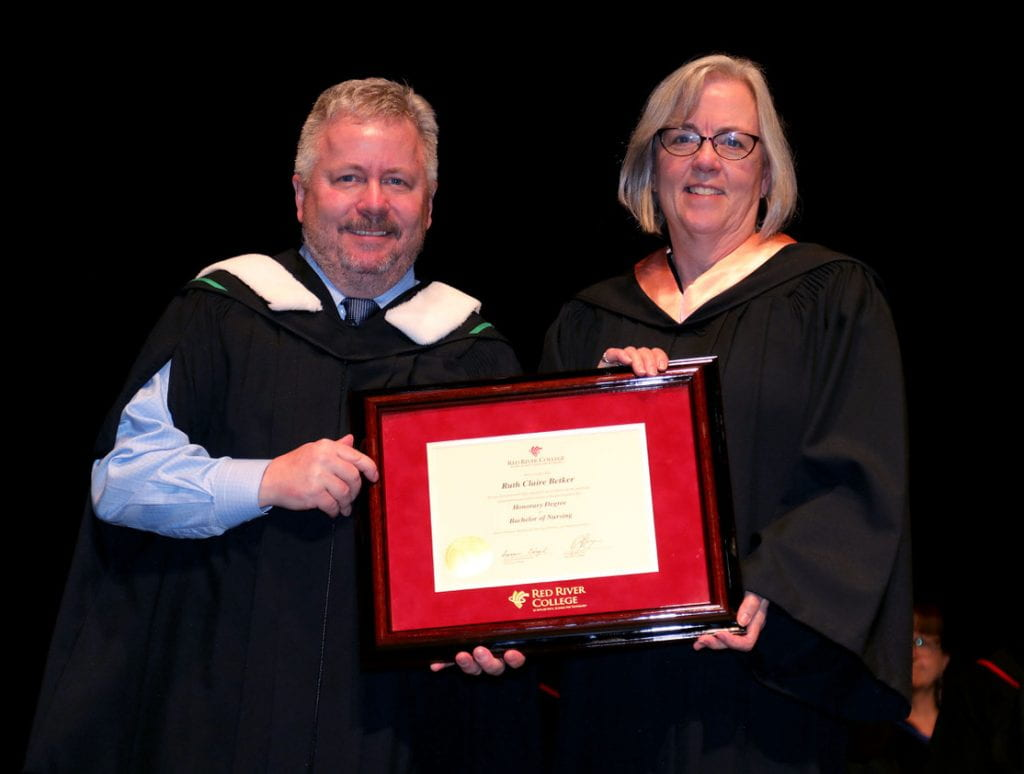 RRC president Darin Brecht presenting honorary degree to Dr. Ruth Betker