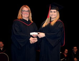 Janice Hyde (vice-chair, RRC Board of Governors) presents Jessica Burzminski with her Lieutenant Governor's Medal