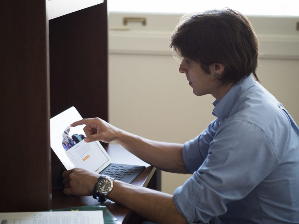 Male student working at desk