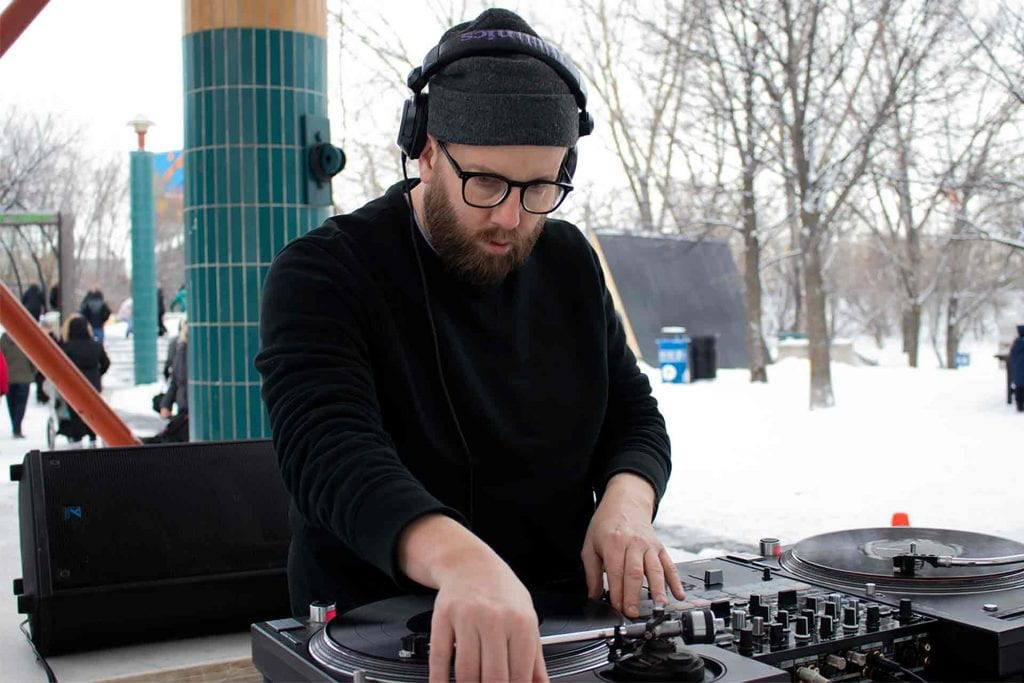 Tyler Sneesby (aka DJ Hunnicutt) spinning records at The Forks