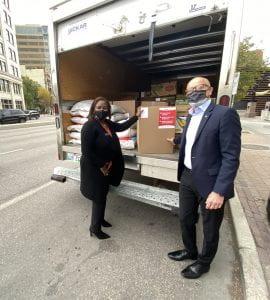 Keren Taylor-Hughes and Fred Meier lcading Winnipeg Harvest truck