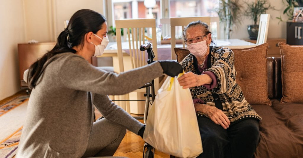 Direct service provider assists elderly woman