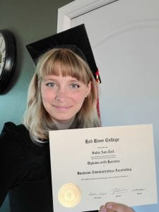 RRC grad Sadie Tait with certificate