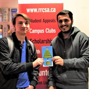 Dylan Shumka (left) receiving the Early Bird Prize $150 Best Buy gift card.