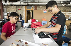 Students building their project at summer camp