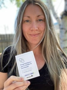 Woman holding vaccination card