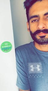 Man with vaccination sticker