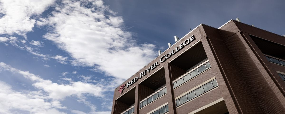 RRC sign on Notre Dame F Building in front of blue sky