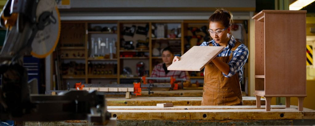 Woman in carpentry shop